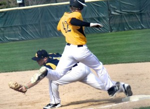 Laker 1B Tom Keating Stretches for the putout. PHOTO BY T.Schardin